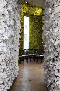 How LUSH-ious is this #event? Fresh #flowers and greenery lining the walls! #EventSpark