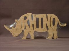 Rhino Rhinoceros Animal Puzzle Wooden Toy Hand  Cut with Scroll Saw on Etsy, $12.00. This would be so cute with an e instead of the o to make Rhine:)