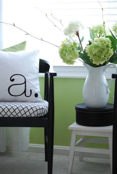 the horseshoe chair is paired with a typography pillow, a simple pitcher full of hydrangeas and an elegant hatbox. A black, white and green color scheme ties the entire grouping together. Budget Bedroom, Bedroom Decor, Bedroom Furniture, Bedroom Wall, Home Goods Decor, Home Decor, Green Color Schemes, Deco Originale, Green Rooms