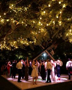 vintage rustic romantic wedding , photo , seating , reception , dance floor, lights , Dancing - After dinner, guests enjoy dancing under the stars and the trees decorated with twinkling lights.