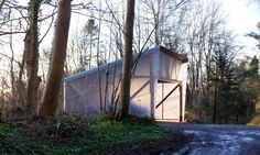 With a name like Ghost Barn and a glowing, lantern-like appearance at night, this fiberglass-clad structure could easily be mistaken for a haunted hut. Rest assured, however, the building is actually a new model-making shed completed by British firm Invisible Studio in the woods of Bath. The architects designed the prototyping workshop using unseasoned spruce timber grown and milled on-site.