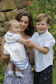 Crown Princess Mary and two of her children, Prince Christian (R) and the twin Prince Vincent Frederik Minik Alexander, pose during a photocall at Grasten Castle on August 1, 2011 in Grasten, Denmark.