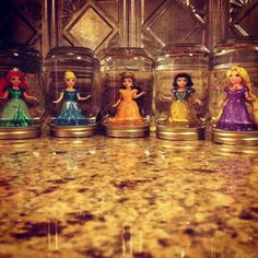 Homemade Disney princess snow globes. Things you need: Mason jar, Glitter flakes, E6000 glue, Glycerin, Water.