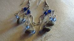 Blue & wood bead wire earrings by DesignByTweet on Etsy, $7.50