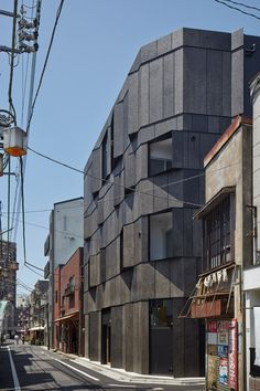 Angled fins flanks the windows of this Tokyo apartment block.