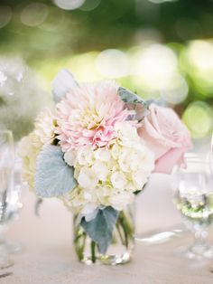 Small floral bunches: Dahlias Hydrangeas Roses | Ryan Ray Photography | See more on #SMP Weddings - http://www.stylemepretty.com/2013/12/05/orchard-wedding-from-ryan-ray-photography/