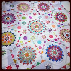 amitie textiles  I'm loving this as a setting for sampler quilt blocks! Nine blocks never looked so interesting! -Suzy :)