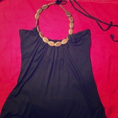 Faux-wood neck detailed tank top The design is meant to look like earthy wood beads, scoops slightly on the back. Extremely lightweight, black top Tops Tank Tops