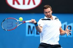 Ernests Gulbis Ernests Gulbis of Latvia plays a forehand in his second round match against Sam Querrey of the United States during day three...