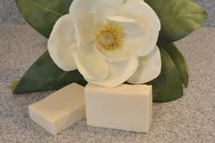 """Southern Magnolia Soap is reminiscent of the south. This soap represents the scent quite beautifully. It is a """"sexy and intoxicating and complex -- with top notes of grapefruit, orange, ylang ylang, hyacinth, and freesia leading to a fruity-floral middle of tuberose, lily of the valley, magnolia (of course!), plum. vanilla, and musk."""""""