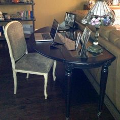 Putting a drop leaf table behind a couch does triple duty as a desk, sofa table and dining space.