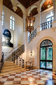 Entry with red and white checkered marble floor, wrought iron doors and expansive staircase in year 2000 Jeffery W Smith designed venetian style palazzo in Palm Beach, FL