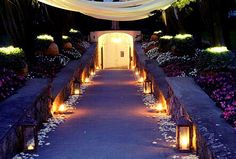 The entrance pathway at twilight with petals and lanterns...