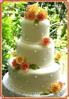 Floral Cake  A wedding cake with orange flowers.