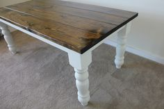 6ft farmhouse all wood rustic barn wood looking dining or kitchen table with baluster turned legs in dark walnut stain and ivory painted base.