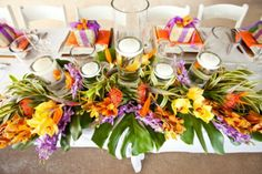 Ginger and orchid flowers used together for flower arrangement on main table