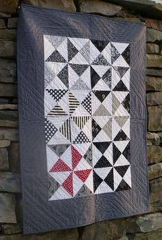 Fabric purchased for this quilt.  CJ? Not crazy about the gray border, take pinwheels to edge, bind in black scraps with a touch of red . Black and White quilt via Flickr