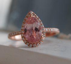 Peach sapphire ring by Eidelprecious. Pave engagement ring, diamond halo, pear cut sapphire, rose gold. #eidelprecious