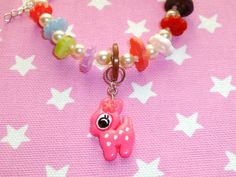 Flower fawn  bead and button bracelet by NiNEFRUiTSPiE on Etsy, £3.50
