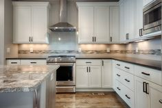 The stainless steel and oil rubbed bronze adds balance character and eclectic style to this custom kitchen Eclectic Style, Oil Rubbed Bronze, Backsplash, Custom Homes, Denver, Kitchen Design, Tile, Kitchen Cabinets, Stainless Steel