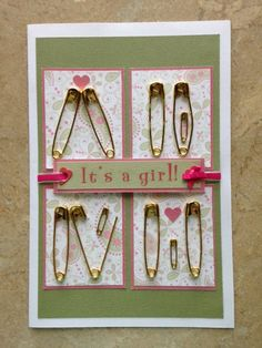 it's a Girl/Boy card with safety pins