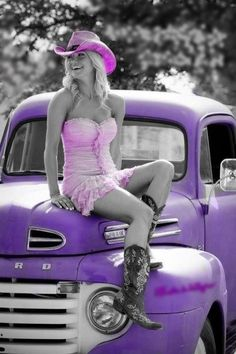 Black white and purple with a splash of pink cowgirl, Ford truck.
