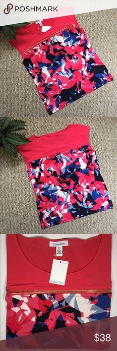 "Calvin Klein Printed Top Sleeveless Calvin Klein Printed Top Sleeveless Horizontal Zipper ✨Size L G/G ✨Color: Pink   Materials: 95% Polyester, 5% Spandex   Measurements: 💞Full Length: 26"" 💞Armpit to Armpits: 20"" Calvin Klein Tops Blouses"