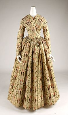 1840-1845 ___ Morning Dress ___ Wool ___ British ___ at The Metropolitan Museum of Art ___ photo 1 ___ (NOTICE: waist is piped along with the armhole piping from the back continuing down the front to waistline point)