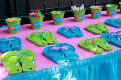 Either set up to actually decorate the flip flops or line up items for pedicures (or both) great for teen or pre-teen parties.