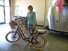 Jackie with her new red step thru Pedego.