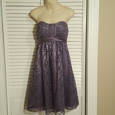 Alfredo Angelo tea length dress Purple metallic lace sets off this beautiful Alfredo Angelo dress. Worn only once for an event. The dress is a muted plum color so it is just the right amount of sparkle for any event. Great condition. Was altered from a size 6 to a size 4 so there are no tags on the inside but the hanger straps show that it is an Alfred Angelo. Length is 28 inches from under the arm to bottom. Alfred Angelo Dresses Strapless