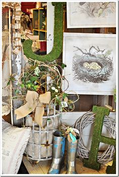 I love the mossy letter with the little wreat/nest next to the vintage bird nest prints. Very charming.