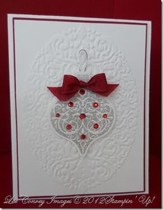 Lee's beautiful card features Ornament Keepsakes & matching framelits and the Holiday Frame embossing folder. She embossed the ornament with a special mix of Dazzling Diamonds glitter & Silver embossing powder. Very cool!