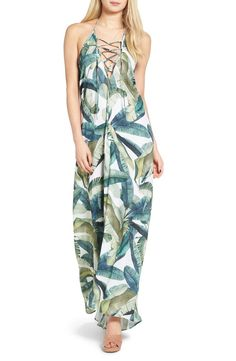 Welcome the return of the sun in this seriously flirtatious maxi dress cut with an exposed back and crisscrossing ties in front.