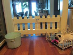 Love this idea instead of baby gates to keep the dogs in the living area.