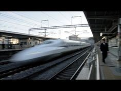The Japanese bullet trains (Shinkansens) roaring past a station.
