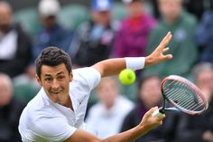 Bernard Tomic in action in his 7-6(3), 3-6, 7-6(8), 3-6 win over Radu Albot in the second round at Wimbledon. #tennis