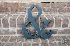 """Check out The Lettered Lane! They specialize in wood letters, wood words and signs, monograms, and small wooden shapes. All of their pieces are hand-cut, sanded, painted, and then distressed. Each piece is made out of 3/4"""" pine wood."""