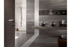 Create your own spa oasis with floor to wall wood-look silver and gray porcelain tile.