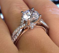 Stunning #Verragio round solitaire with a twisted pave shank and rose gold inlay!