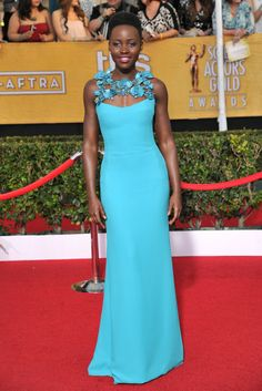 Arguably the most electrifying hue at the 20th annual SAG Awards, Lupita Nyong'o's one-of-a-kind Gucci gown helped solidify her rise as a style star. [Photo by Donato Sardella]