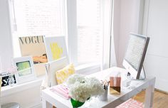 @Alaina Kaczmarski of The Everygirl // office space // large windows // white parsons desk from @west elm // pink greek key rug @Rugs USA // @Joss and Main pouf // photography by Stoffer Photography