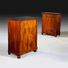A fine pair of French Empire Mahogany Side Cabinets ( Meubles d'Appui ) : Nicholas Wells Antiques A very fine and rare pair of French Empire period cabinets in highly figured Cuban mahogany.
