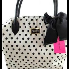 Betsey Johnson Nylon white and black polka dot bag Brand new with tags.  Front is white with black dots and backside is black with white dots.  Black ribbon bow on front.  Very spacious!  Photos don't do it justice. Betsey Johnson Bags