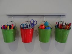 Buckets for Craft Organization -- from 150 Dollar Store Organizing Ideas and Projects for the Entire Home