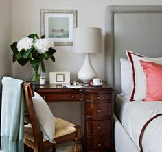 Love the idea of an old, small desk as a nightstand.