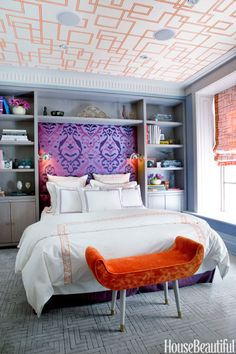 In the guest room, Gorrivan framed the bed with cerused-oak bookcases. Headboard upholstered in Dedar's Bukara. The custom Holland & Sherry wallcovering on the ceiling echoes the pattern on the Roman shades, Roma Key by Gorrivan for Highland Court. Custom linens from Leontine.