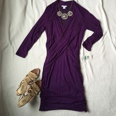 ✨✨WITH TAGS!! Beautiful purple dress! **new with tags***This is a listing for a beautiful long sleeve purple dress… super soft material...Very forgiving and very flattering… Double lined to give a smooth appearance...Size large 4/6 dress size...hits right above the knee... Bracelet length sleeve .Great for the office or for going out on the town! Dresses Long Sleeve