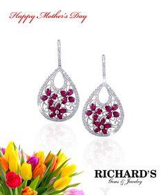 Pear shape ruby flower and diamond drop earrings in 18k white gold