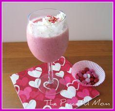 Valentine's breakfast...strawberry banana smoothies and heart shaped waffles!